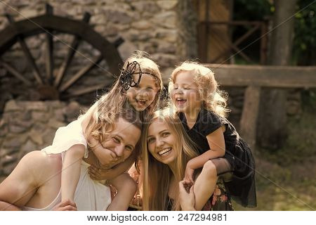 Family Life. Summer Vacation, Adventure, Discovery, Wanderlust Concept. Girls Sit On Woman And Man S