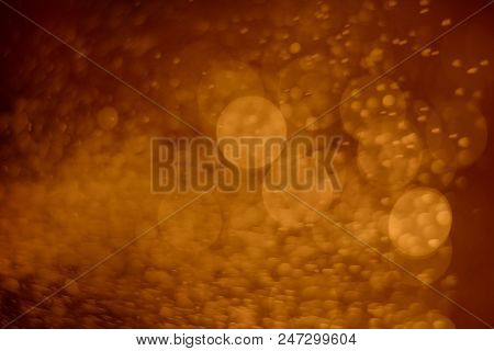 Gold Abstract Bokeh Light On Golden Background