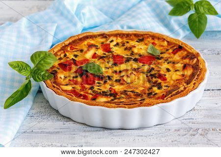 Ceramic Mold With Savory Chicken Pie, Green Onion And Sweet Pepper On White Wooden Table.