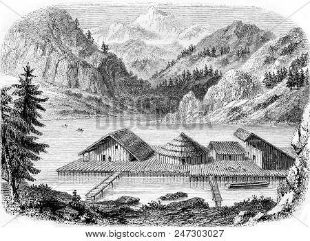 Gallic village on stilts, not far from the village of Milan, Lake Zurich, Restoration after the discoveries of 1851, vintage engraved illustration. Magasin Pittoresque 1855.