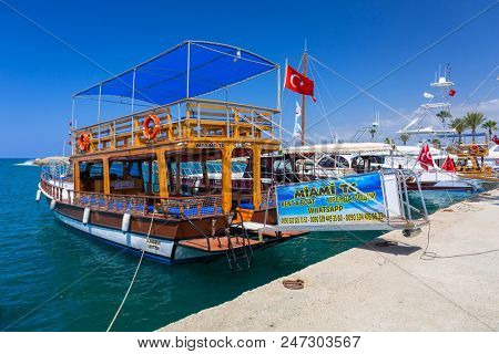 Side, Turkey - June 8, 2018: Fishing boats in the harbor of Side, Turkey. Side  is an ancient Greek city on the southern Mediterranean coast of Turkey.
