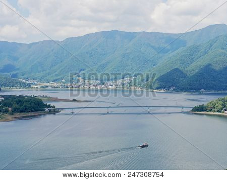 Scenery Of Lake Kawaguchi, The Biggest Lake Of Fuji Five Lakes, With A Ferry Boat And An Overwater B
