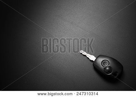 Car Key With Central Lock On Black Background