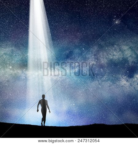 conceptual image of silhouetted man and abstract universe lights.