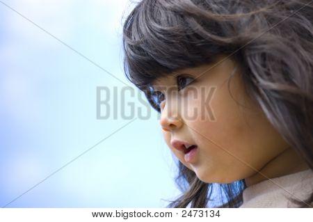 Wondering Child Against Blue Sky