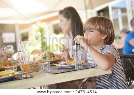 Family on vacation having lunch at hotel restaurant