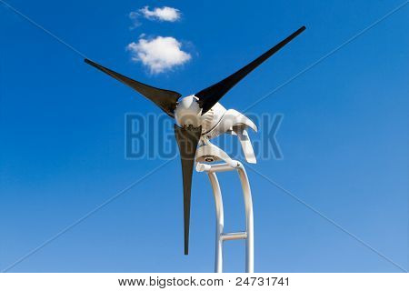 Home Sized Windmill Wind Turbine Isolated Blue Sky