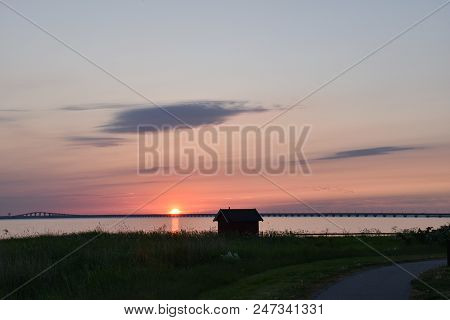Colorful Sunset By The Coast Of The Swedish Island Oland With The Oland Bridge In The Background