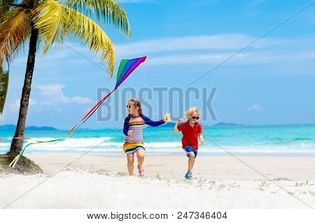 Child With Kite. Kids Play. Family Beach Vacation.