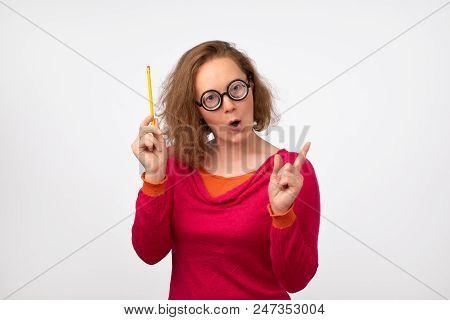 Closeup Portrait Funny European Woman Thinking Like She Has A Good Idea Isolated On Gray Wall Backgr