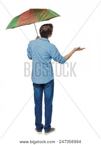Rear view of a man with an umbrella. Rear view people collection.  backside view of person.  Isolated over white background. The guy is standing in the rain