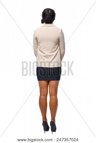 Back view of an African-American woman in suit. girl  watching. Rear view people collection.  backside view of person. Isolated over white. Black business woman standing with arms crossed on chest