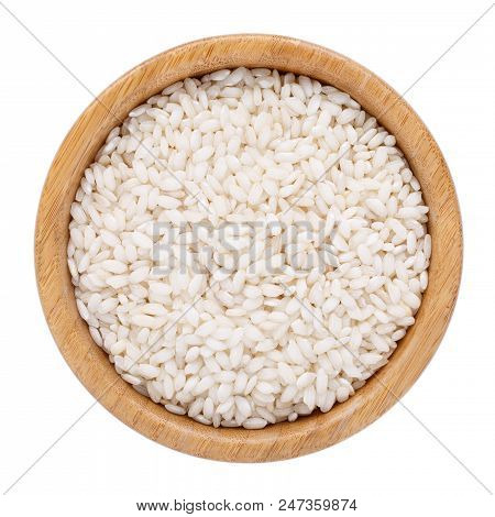Arborio Short Grain Rice In Wooden Bowl Isolated On White. Top View.