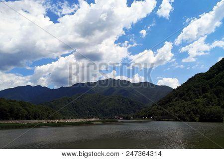 European Route E81 Passing Through Mountains Next To The Olt River In Romania.