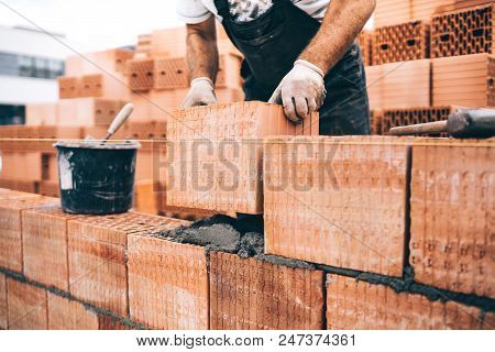 Industrial Worker, Bricklayer Using Tools And Bricks For Building House. Mason Details