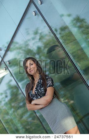 smiling woman near glass wall