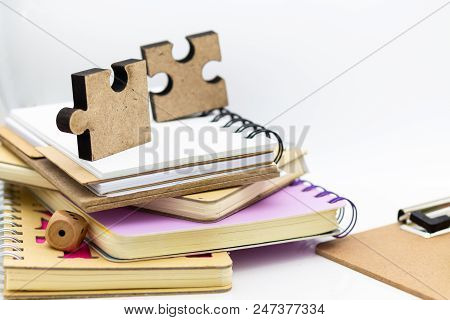 Jigsaw Puzzle Piece On The Stack Of Books, Image Use For Solving Problems, Education Background Conc