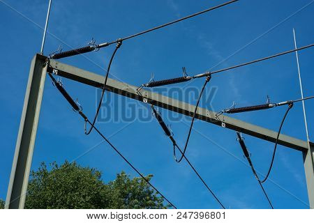 Detail Substation In Nature With Electricity Pylons In Sunny Weather