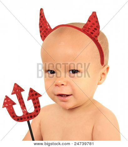One year old baby boy of Caucasian and Asian heritage wearing devil horns.
