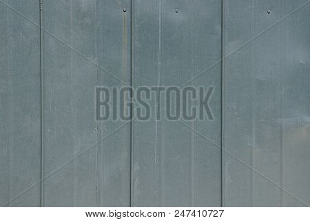 Gray Texture Of A Piece Of Metal On The Wall