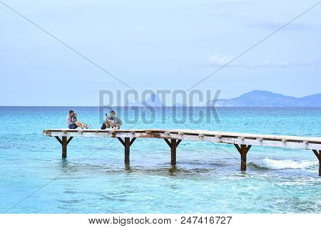 Formentera Island, Spain - May 4, 2018: People Taking A Picture In The Wooden Boardwalk, Picturesque