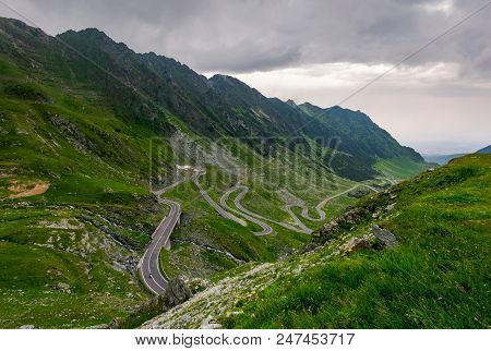 Winding Serpentine Of The Transfagarasan Road. Beautiful Transportation Background. Popular Tourist
