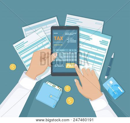 Internet Payment Of Taxes, Invoice, Bill, Banking. Man Hand Holding The Phone And Presses The Pay Bu