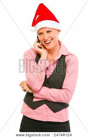 Smiling Modern Business Woman In Santa Hat Talking Cell Phone