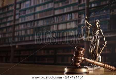Law And Justice Theme - Court Library. Gavel And Themis Statue.