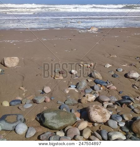 Big Striped Rock Stone & Sand Background Frame On Beach. Stone  As Natural Rock Abstract Texture Pat