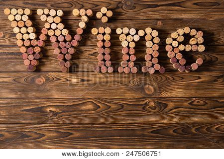Decorative Used Red And White Wine Bottle Corks Spelling The Word Wine On A Rustic Wood Background W