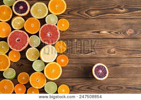 Colorful Display Of A Variety Of Cut Citrus Fruits With Oranges, Grapefruit, Clementine, Lime, Lemon