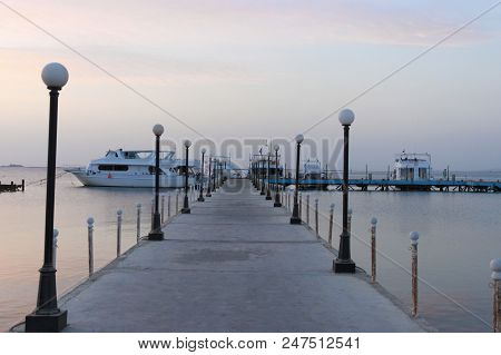Pier And Ships On The Sea. The Pre-dawn Sky. A Minute Before Sunrise. Red Sea, Safaga, Egypt.