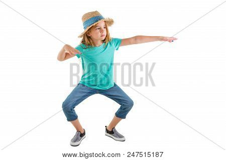 Young Girl In Casual Denim Jeans And A Straw Hat Standing Making Funky Dance Moves Bending At The Kn