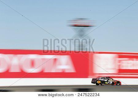 June 24, 2018 - Sonoma, California , USA: Martin Truex, Jr (78) races for the TOYOTA/SAVE MART 350 at Sonoma Raceway in Sonoma, California .