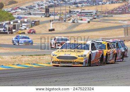June 24, 2018 - Sonoma, California , USA: Trevor Bayne (6) Races through turn ten at the TOYOTA/SAVE MART 350 at Sonoma Raceway in Sonoma, California .