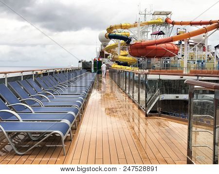 Cruising The Caribbean Of The Carnival Magic Cruise Ship - 11/29/17 - Deck Chairs And Water Slide Ar