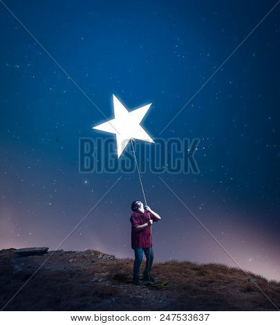 Kid Drag A Star Towards Him With A Rope In The Middle Of The Night. The Concept Of Accomplish His Dr