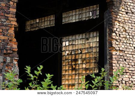 Damaged And Dusty Luxfers In A Window Of An Abandoned Industrial Building