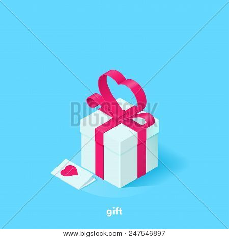 White Gift Box With A Pink Ribbon In The Form Of A Heart And A Greeting Card On A Blue Background, I