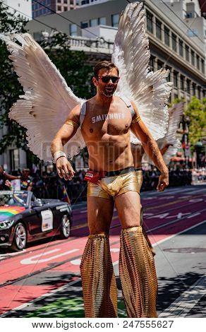 Gay Pride Parade In San Francisco - Corporate Smirnoff Liquor Marches With Angles On Stilts
