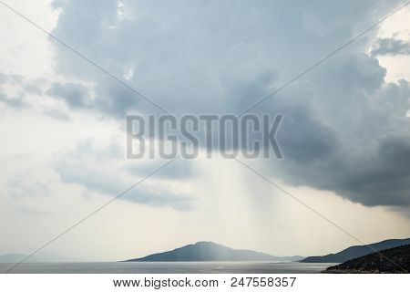 Rain And Storm Clouds On The Sea Bay Of Bodrum, Turkey. The Streams Of Rain Fall Into The Open Sea B