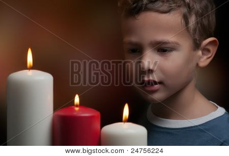Kid Watching Candles