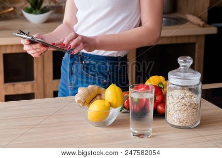 Counting Calories. Woman Reading Her Diet Plan. Healthy Lifestyle And Balanced Eating For Weight Los