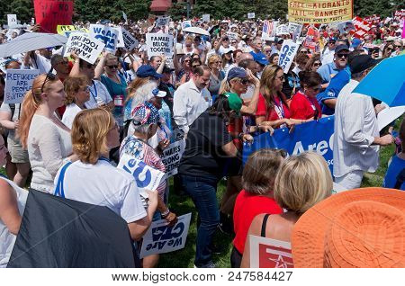 Mpls, Mn/usa - June 30, 2018: Protesters Gather Holding Signs As Part Of The National Rally Families