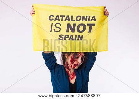 Woman was victim of riots of catalan protesting for spanish government decision about referendum of independence of catalunya. poster
