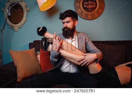 Brutal Bearded Man Embracing Stroking Pretty Woman Long Legs. Elegant Couple. Beautiful Woman Near M