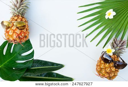 Summer Flat Lay Frame With Pair Of Funny Pineapple Friuts And Tropical Leaves, Summer Family Travel
