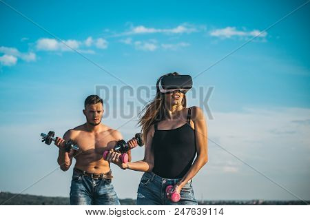 Training On Fresh Air. Training With Vr And Gym Equipment. Training Woman And Man On Blue Sky. Train