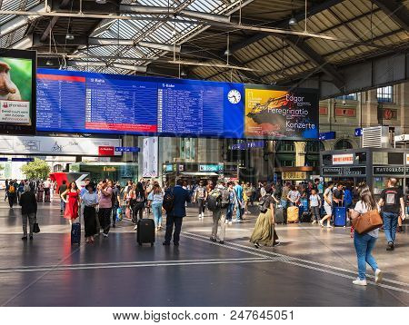 Zurich, Switzerland - June 30, 2018: People And Arrival Departure Board In The Hall Of The Zurich Ma